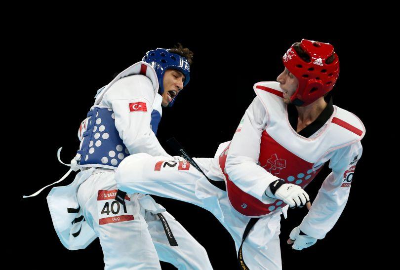 Turek Servet Tazegul (L) triumfował w kategorii 68 kg (fot. Getty Images)