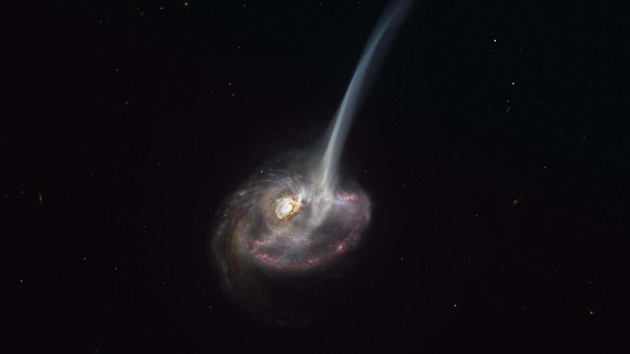 Galaktyka ID2299 znajduje się 9 mld lat świetlnych od Ziemi (graf. ESO/M. Kornmesser)