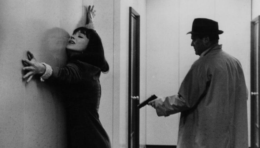 "Anna Karina w 1965 r., w ""Alphaville"" z  Eddie'm Constantine'm (fot.  Michael Ochs Archives/Getty Images)"